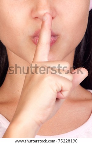 Portrait of adorable girl ordering silence isolated on white background - stock photo