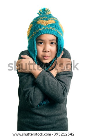 portrait of adorable happy child cold girl in warm hat , isolated on white - stock photo