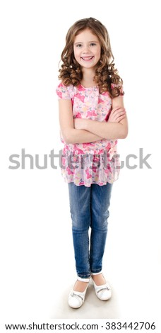 Portrait of adorable happy little girl in jeans isolated on a white - stock photo