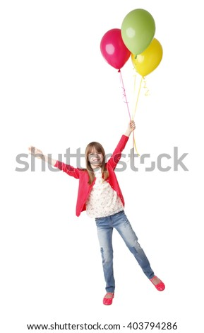 Portrait of adorable little girl holding in her hand balloons while standing at isolated background. - stock photo