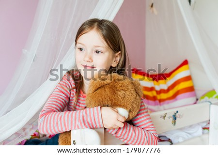 Portrait of adorable little girl in her room - stock photo