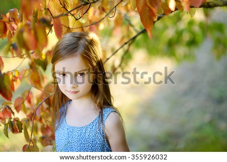 Portrait of adorable little girl outdoors on warm and sunny summer day - stock photo