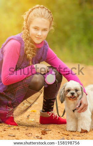 Portrait of adorable little girl posing with ??dog - stock photo