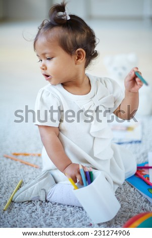 Portrait of adorable little girl with colorful pencils - stock photo