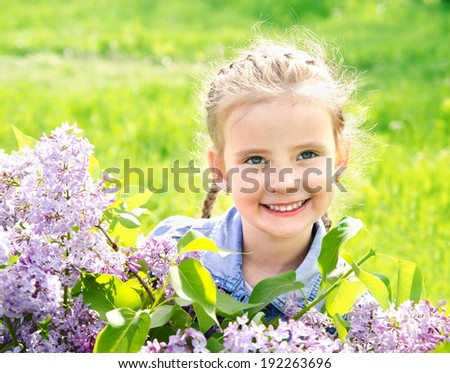 Portrait of adorable smiling little girl on the meadow outdoor