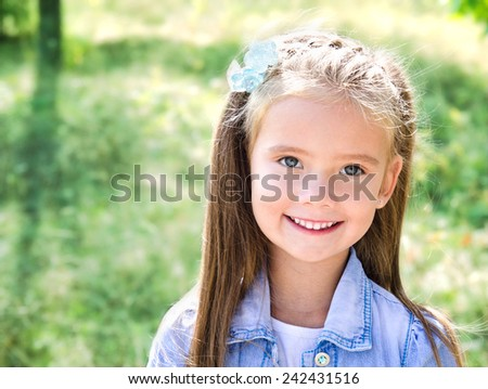 Portrait of adorable smiling little girl outdoor - stock photo