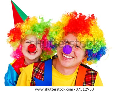 Portrait of adult and little clowns, isolated - stock photo