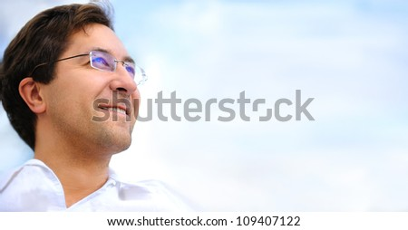 Portrait of adult man looking to sky and copyspace. Cheerful leader
