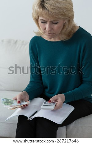 Portrait of adult woman analyzing home budget