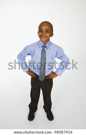 Portrait of African American boy with hands on hips - stock photo