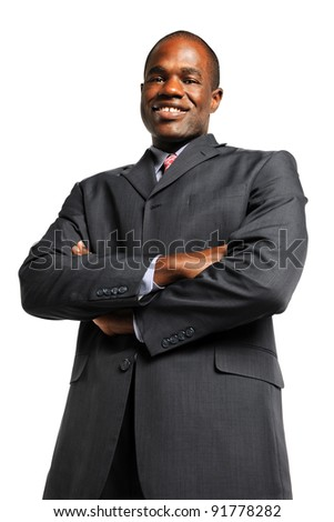 Portrait of African American businessman smiling with arms crossed isolated over white background