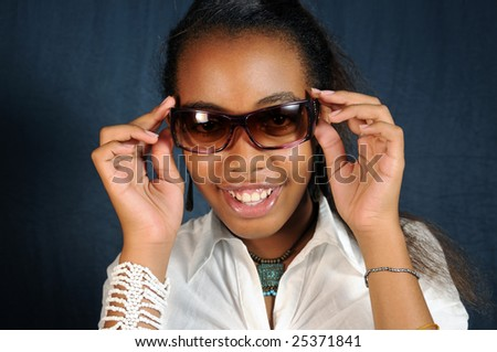 Portrait of african american fashion teen girl wearing sunglasses - stock photo