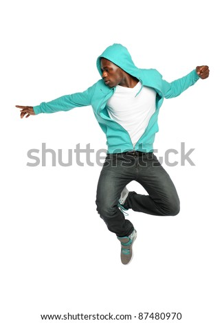 Portrait of African American hip hop dancer jumping isolated over white background - stock photo