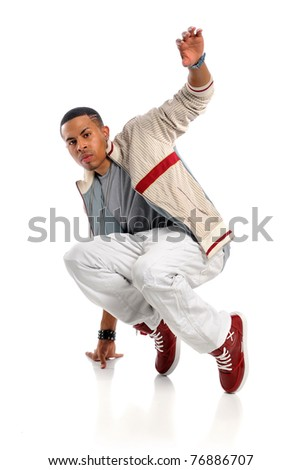 Portrait of African American hip hop dancer performing isolated over white background - stock photo