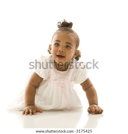Portrait of African American infant girl against white background.