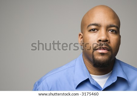 Portrait of African American man against gray background. - stock photo