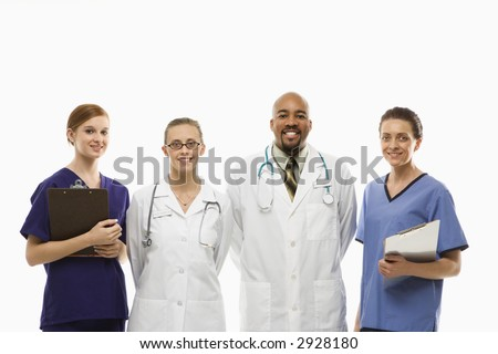 Portrait of African-American man and Caucasian women medical healthcare workers smiling in uniforms standing against white background.
