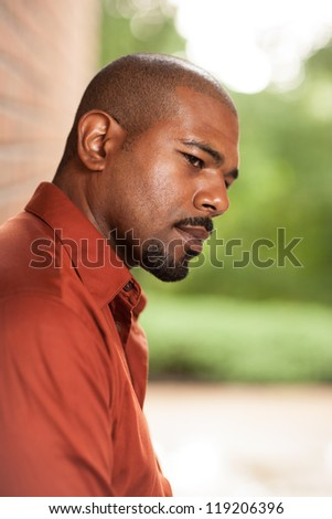 Portrait of African American man thinking - stock photo