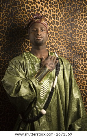 Portrait of African- American mid-adult man wearing traditional African clothing. - stock photo