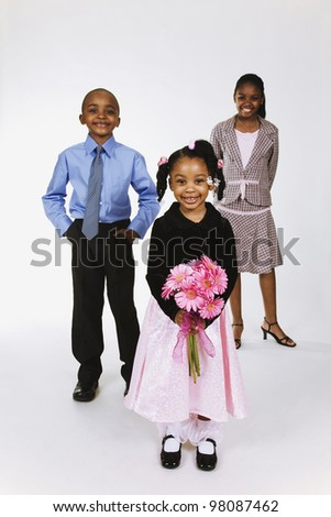 Portrait of African American siblings wearing Sunday clothes - stock photo