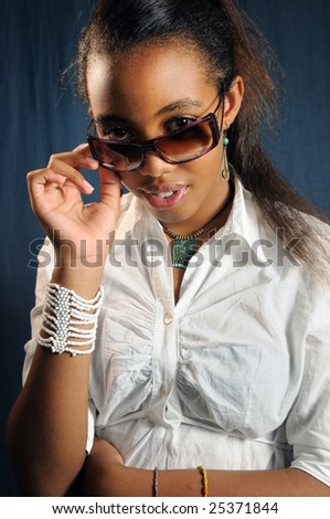 Portrait of african american teen girl wearing sunglasses - stock photo