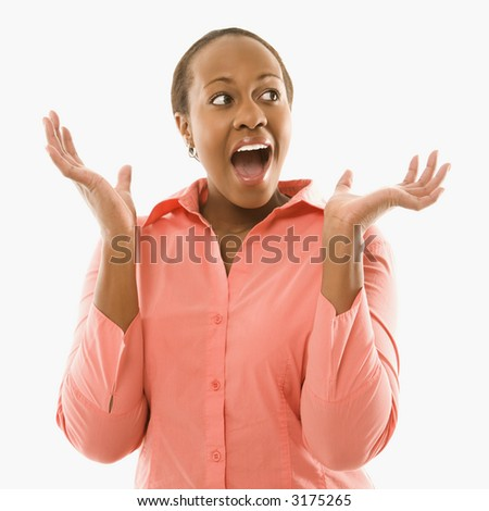 Portrait of African American woman looking surprised against white background. - stock photo