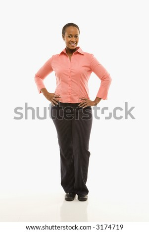 Portrait of African American woman standing smiling against white background. - stock photo