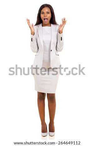 portrait of african businesswoman looking surprised on white background - stock photo