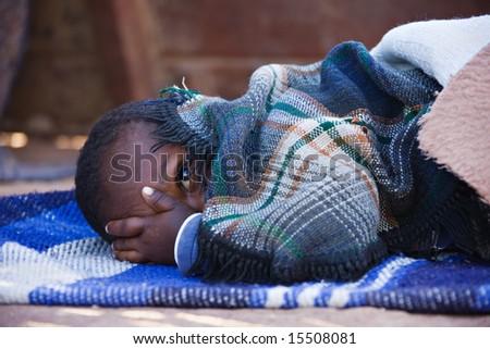 Portrait of African child sleeping in the yard , location Mmankodi village , Botswana - stock photo