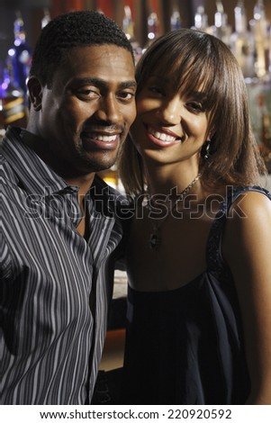 Portrait of African couple at bar - stock photo