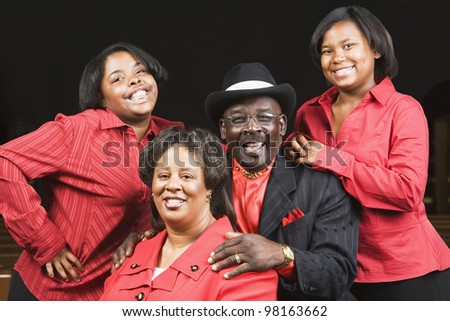 Portrait of African family wearing matching clothing