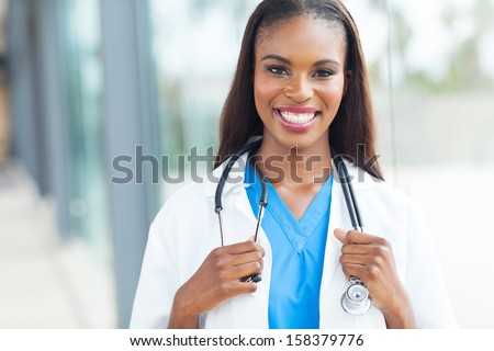 portrait of african female doctor at workplace - stock photo