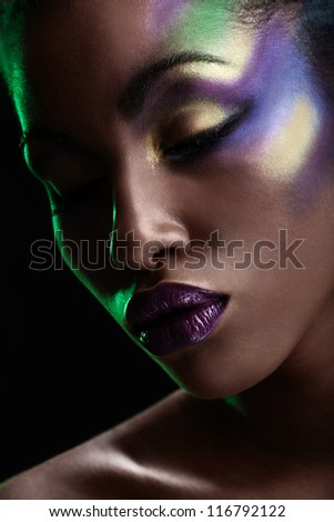 portrait of african girl with close eyes on black background - stock photo