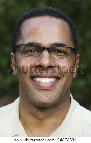 Portrait of African man with glasses - stock photo