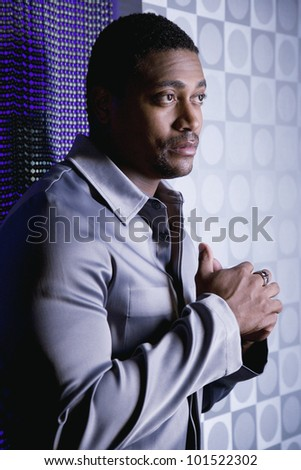 Portrait of African man with hands clasped - stock photo