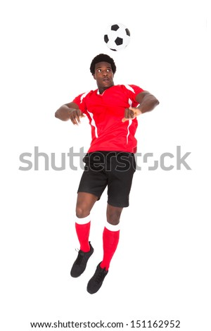 Portrait Of African Soccer Player Playing With Football Over White Background - stock photo