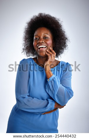 Portrait of african woman laughing on white background - stock photo