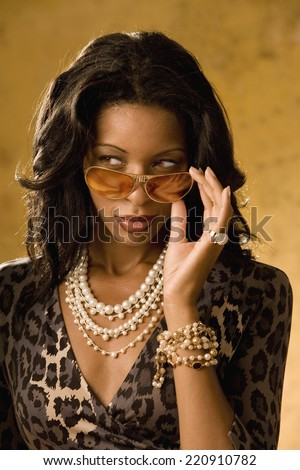 Portrait of African woman wearing sunglasses - stock photo