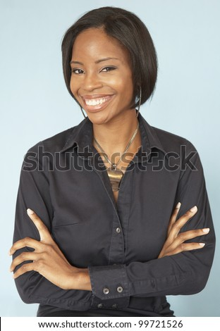 Portrait of African woman with arms crossed - stock photo