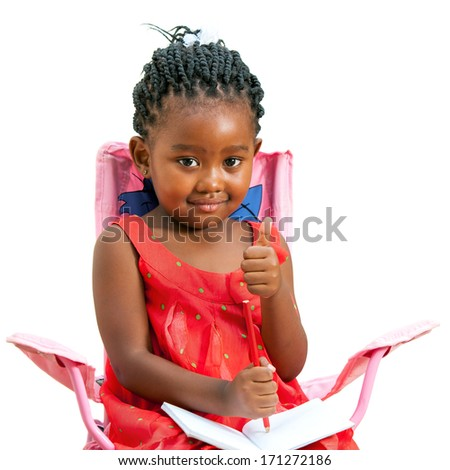 Portrait of African youngster with note book doing thumbs up.Isolated on white background. - stock photo