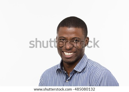 Portrait of Afro-American businessman happy smiling in studio. Handsome man in shirt looking at camera isolated on white.