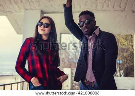 Portrait of afro american guy with caucasian female in sunglasses. - stock photo