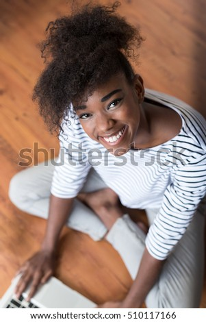 portrait of afro american working from home. Woman freelancing from home