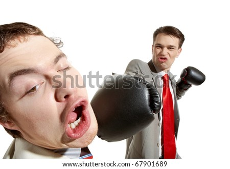 Portrait of aggressive businessman in boxing gloves kicking his rival - stock photo