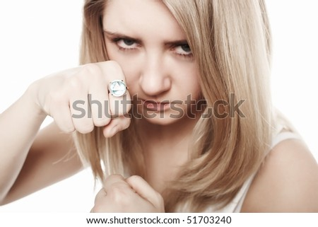 Portrait of agressive young blondy showing her fist with jewellery