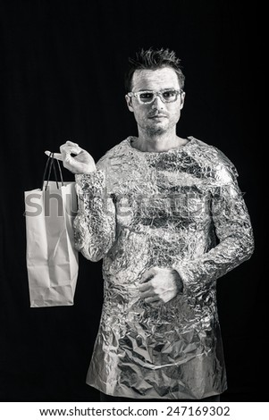 Portrait of alien man holding shopping bag. - stock photo