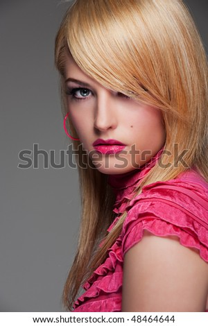 portrait of alluring woman against grey background - stock photo