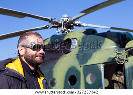Portrait of Alpine Climber Preparing for Boarding to Helicopter for Flight to High Altitude Mountain Camp in Remote inaccessible area