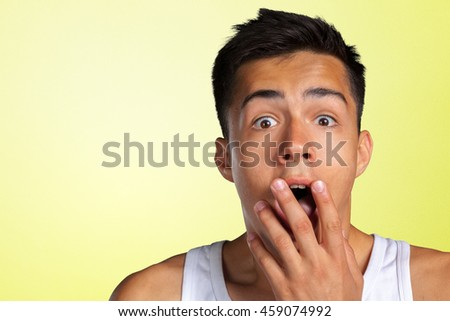 portrait of amazed man covering his mouth  - stock photo