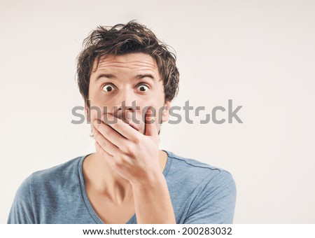 portrait of amazed man in studio - stock photo